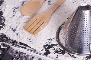 kitchen utensils on  flour