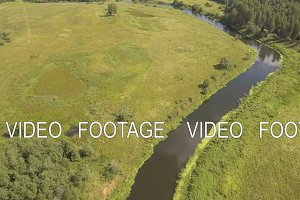 Flying over the river.Aerial video.