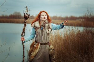 Woman is a shaman with a staff in he