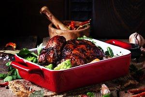 Baked chicken in glaze with vegetabl