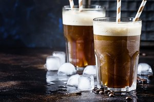 Cold frappe coffee with ice and foam