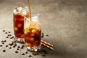 Ice coffee in a tall glass with