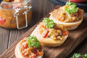 Bread toasts with eggplant caviar.