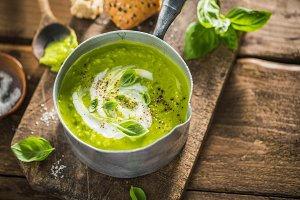 Green pea creamy soup in pot