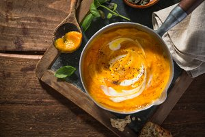 Autumn pumpkin creamy soup in pot