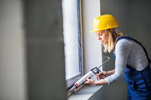 Young woman worker using silicone