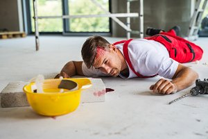 A man worker lying on the floor