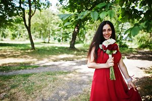 Cute girl bridesmaid at red dress wi