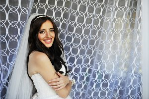 Beautiful smiling brunette bride at