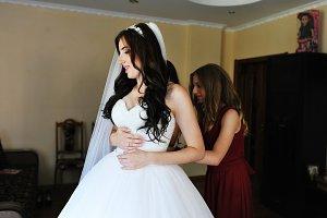 Happy cheerful brunette bride wearin