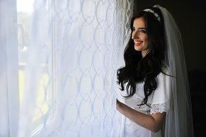 Beautiful brunette bride at morning