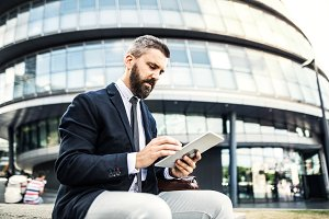 Hipster businessman with tablet