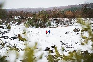 A senior couple jogging in snowy