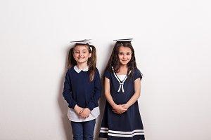 Two small schoolgirls with uniform
