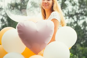 young girl with balloons on nature b