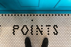 Feet selfie on art pattern tile floo