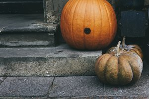 Two pumpkins at the entrance of the