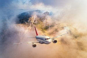Airplane flying above mountains
