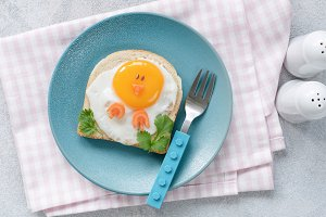 Breakfast for kids. Funny egg toast