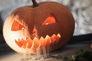 Scary pumpkin lantern with creepy fa