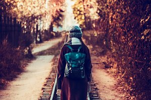 girl walking along an railway