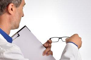 Optometrist back adjusting glasses