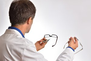 Optician on his back showing glasses