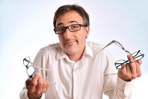 Man shrugging shoulders with glasses