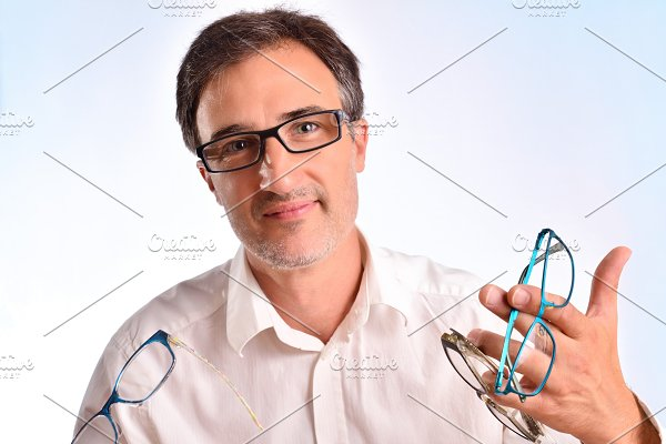 36511457046e Modern man with glasses looking left ~ Health Photos ~ Creative Market