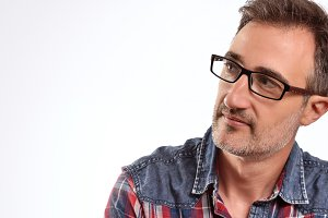 Modern man with glasses looking left