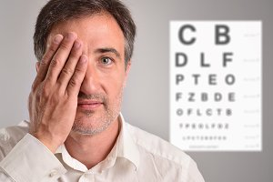Man covering eye for revision detail
