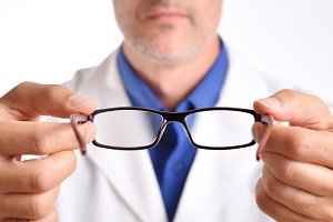 Doctor putting glasses detail