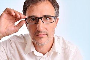 Attractive man adjusting eyeglasses