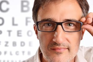 Attractive man eyeglasses detail