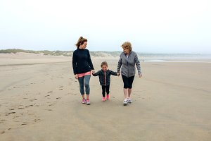 Three generations female walking on