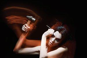 Horror: strange mad girl with hammer