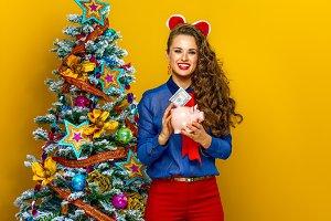 woman near Christmas tree putting do