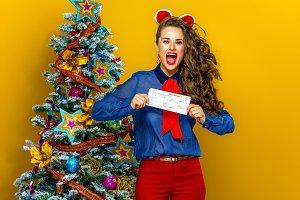 smiling woman near Christmas tree sh