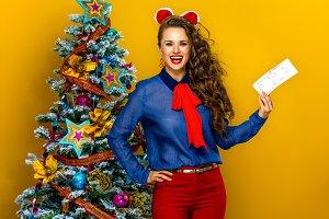 happy woman near Christmas tree show