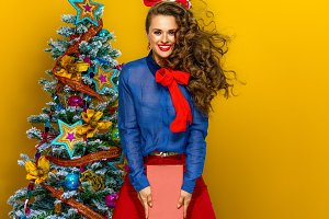 happy elegant woman near Christmas t