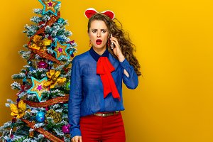 stressed woman near Christmas tree t