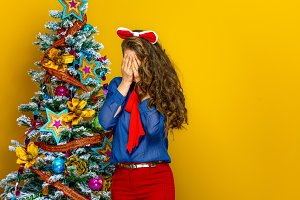 stressed woman near Christmas tree i