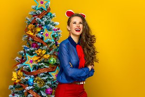 happy woman near Christmas tree look