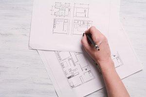 Architect drawing blueprints
