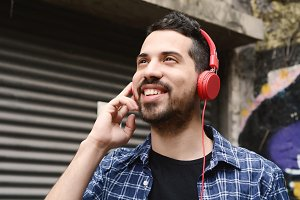 Latin man listening music with headp