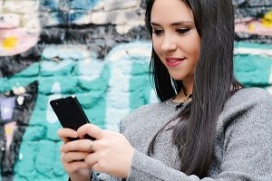 Young woman sending messages with he