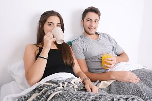 Couple having breakfast in bed.