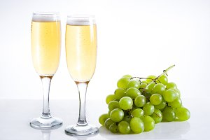 Champagne glasses and green grapes