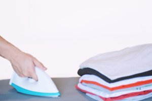 View of man ironing on ironing board