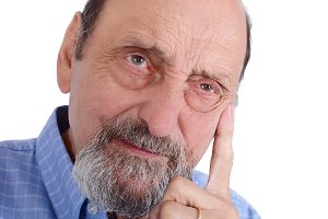 Portrait of elderly man thinking on
